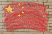 Flag of China on grunge brick wall painted with chalk — Stock Photo