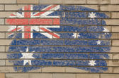 Flag of Australia on grunge brick wall painted with chalk — Stock Photo
