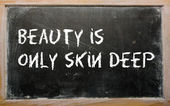"""Beauty is only skin deep"" written on a blackboard — Stock Photo"