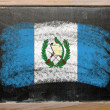 Stock Photo: Flag of Guatemalon blackboard painted with chalk