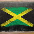 Stock Photo: Flag of Jamaicon blackboard painted with chalk