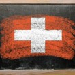 Flag of schwitzerland on blackboard painted with chalk - Zdjęcie stockowe