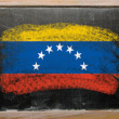 Flag of venezuela on blackboard painted with chalk - Stok fotoğraf