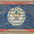 Flag of belize on grunge brick wall painted with chalk — Stock fotografie