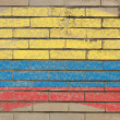 Flag of Columbia on grunge brick wall painted with chalk — Stockfoto