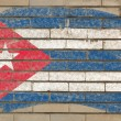 Flag of Cuba on grunge brick wall painted with chalk — ストック写真