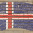 Flag of iceland on grunge brick wall painted with chalk — Stockfoto