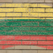 Flag of lithuania on grunge brick wall painted with chalk — ストック写真