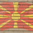 Flag of macedonia on grunge brick wall painted with chalk — ストック写真