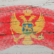 Stock Photo: Flag of montenegro on grunge wooden texture painted with chalk