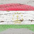 Flag of tajikistan on grunge wooden texture painted with chalk - Стоковая фотография