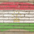 Flag of tajikistan on grunge brick wall painted with chalk - Lizenzfreies Foto