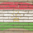 Flag of tajikistan on grunge brick wall painted with chalk - Стоковая фотография