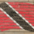 Flag of trinidad and tobago on grunge brick wall painted with ch — Stock Photo