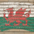 Flag of wales on grunge brick wall painted with chalk - Стоковая фотография
