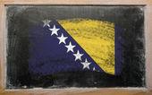 Flag of bosnia and herzegovina on blackboard painted with chalk — Stock Photo