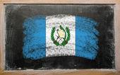 Flag of Guatemala on blackboard painted with chalk — Stock Photo
