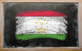 Flag of tajikistan on blackboard painted with chalk — Stock Photo