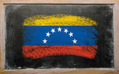 Flag of venezuela on blackboard painted with chalk — Zdjęcie stockowe