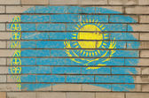 Flag of Khazakstan on grunge brick wall painted with chalk — Stock Photo