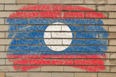 Flag of laos on grunge brick wall painted with chalk — Stock Photo