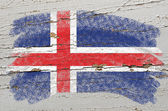 Flag of iceland on grunge wooden texture painted with chalk — Stock Photo