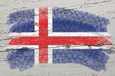 Flagge von island auf grunge holz textur mit kreide gemalt — Stockfoto