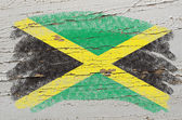 Flag of jamaica on grunge wooden texture painted with chalk — Foto Stock