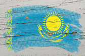 Flag of khazakstan on grunge wooden texture painted with chalk — Stock Photo