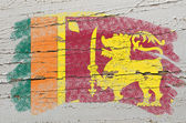 Flag of srilanka on grunge wooden texture painted with chalk — Stock Photo