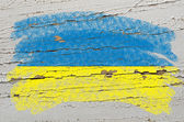 Flag of ukraine on grunge wooden texture painted with chalk — Stock Photo