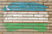 Flag of uzbekistan on grunge brick wall painted with chalk — Stock Photo