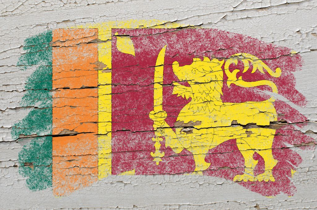 Chalky srilankan flag painted with color chalk on grunge wooden texture — Stock Photo #7135432