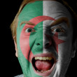 Face of crazy angry man painted in colors of algeria flag — Stock Photo