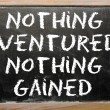 "Proverb ""Nothing ventured, nothing gained"" written on a blackboa — Stock Photo"