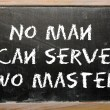 Proverb No man can serve two masters written on a blackboard — Stock Photo