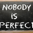 "Foto de Stock  : Proverb ""Nobody is perfect"" written on blackboard"