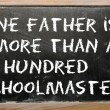 "Stok fotoğraf: Proverb ""One father is more thhundred schoolmasters"" writte"