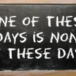 "Stok fotoğraf: Proverb ""One of these days is none of these days"" written on b"