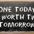 "Proverb ""One today is worth two tomorrow"" written on blackboar — Stock Photo #7296334"