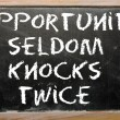 "Stock Photo: Proverb ""Opportunity seldom knocks twice"" written on blackboar"