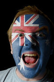 Face of crazy angry man painted in colors of australia flag — Stock Photo