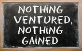 """Proverb """"Nothing ventured, nothing gained"""" written on a blackboa — Stock Photo"""