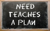 "Proverb ""Need teaches a plan"" written on a blackboard — Stock Photo"