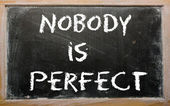 "Proverb ""Nobody is perfect"" written on a blackboard — Stock Photo"