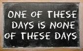 """Proverb """"One of these days is none of these days"""" written on a b — Stock Photo"""