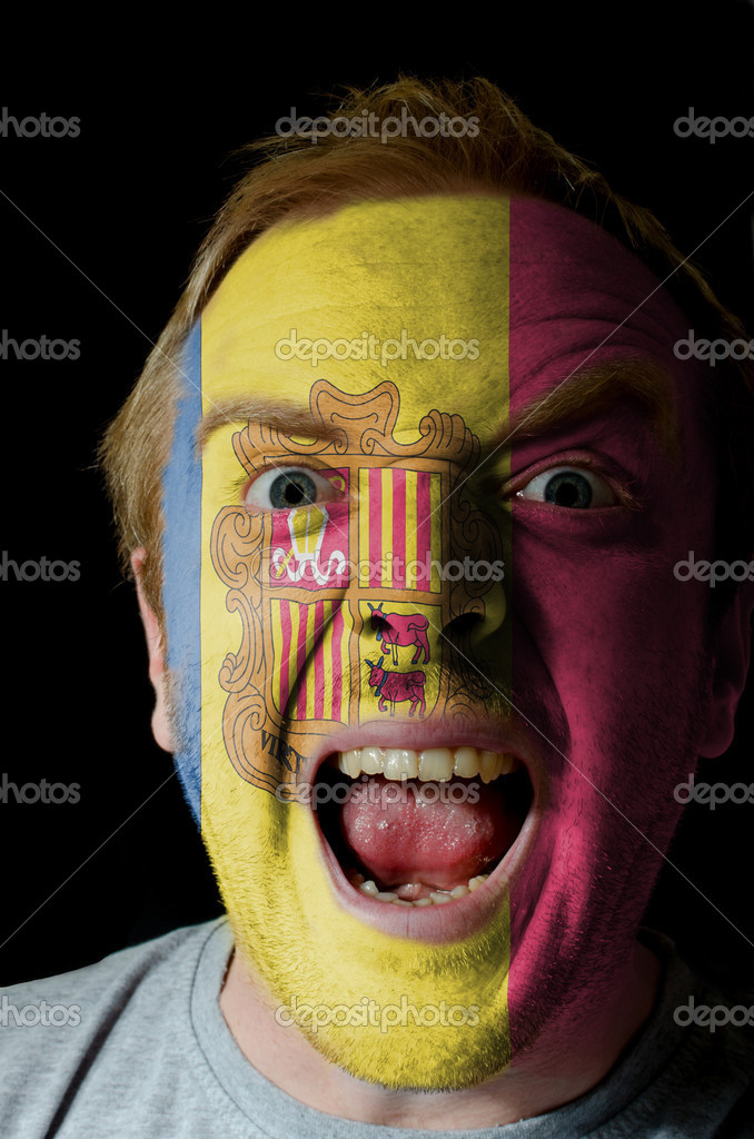 Low key portrait of an angry man whose face is painted in colors of andoran flag  Stock Photo #7295965
