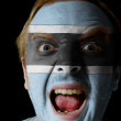 Face of crazy angry man painted in colors of Botswana flag — Stock Photo