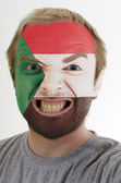 Face of crazy angry man painted in colors of Sudan flag — Stock Photo