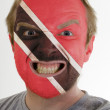 Face of crazy angry man painted in colors of Trinidad and Tobago — Stock Photo #7338497